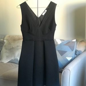 Sandro black dress with v neck, brand new.